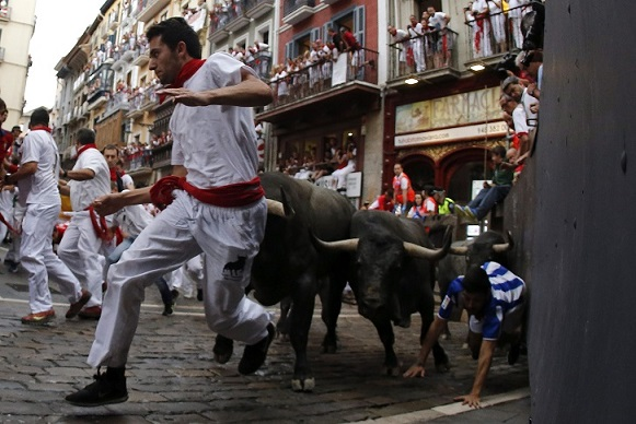 Pasaulio naujienos nuotraukose: bėgimas su buliais Pamplonoje – Ispanija